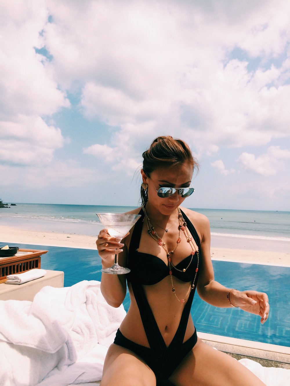Martini in hand, sunshine, and beach = happy camper