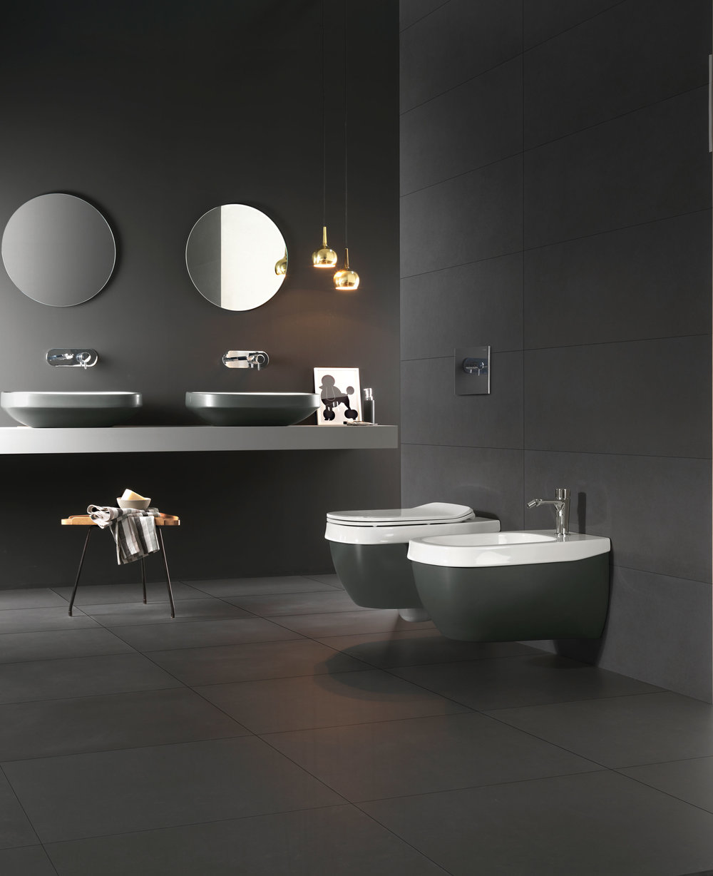 Michel César Hatria Abito black basins and wall-hung bidet and toilet.