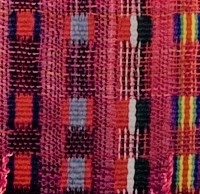 """detail from """"Remembrance"""" by Jo Aylwin (2014): hand dyed and woven.  This piece is woven in Weavers Bazaar 7/2 Blue Face Leicester yarn, hand dyed using acid dyes with colours inspired by World War I medal ribbons."""