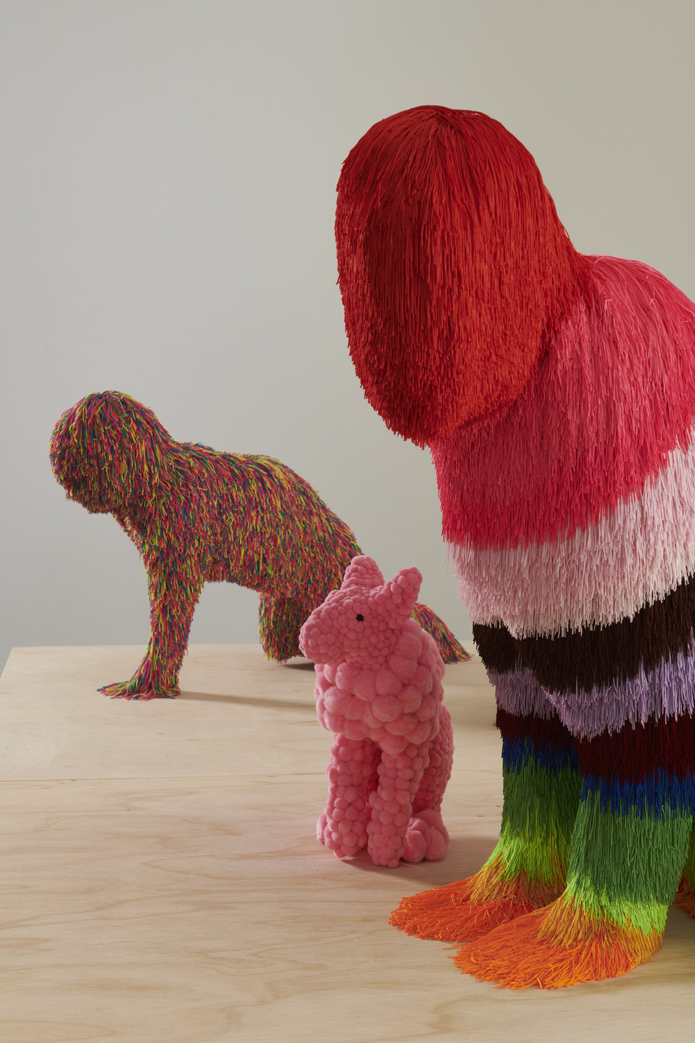 Troy Emery, L- R,  late night binge , 2018 polyester, polyurethane, pins, adhesive,  pink spy , 2017, polyurethane, polyester, pompoms, glue, glass eyes, plastic ear liners,  big rainbow cat , 2018, polyester, polyurethane, pins, stables, adhesive. Photo Fred Kroh.