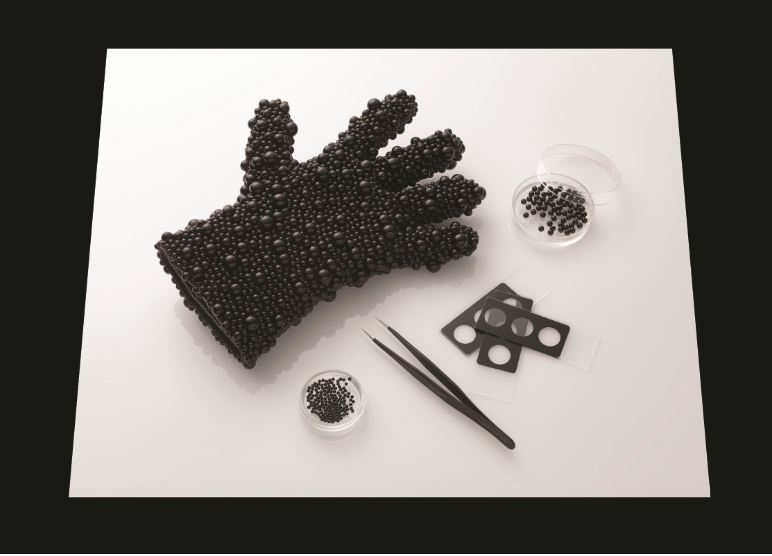 Catherine Truman,  In Preparation for Seeing: SEM Glove Installation,  2015, black cotton glove encrusted with black glass spheres, mircoscope slides, steel forceps, petri dishes, light pad. Dimensions variable. Photo: Grant Hancock