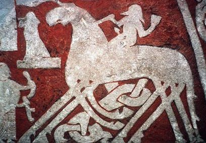A depiction of Oðinn riding on his horse Sleipnir from the  Tjängvide image stone . Within Norse paganism, Oðinn was the deity primarily associated with  Seiðr .