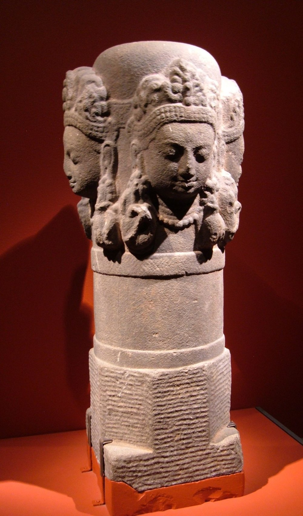 A 10th-century four-headed stone lingam (Mukhalinga) from Nepal. Lord Shiva is pictured as emerging from the Lingam – the cosmic pillar of fire – proving his superiority over the gods  Brahma  and  Vishnu . [