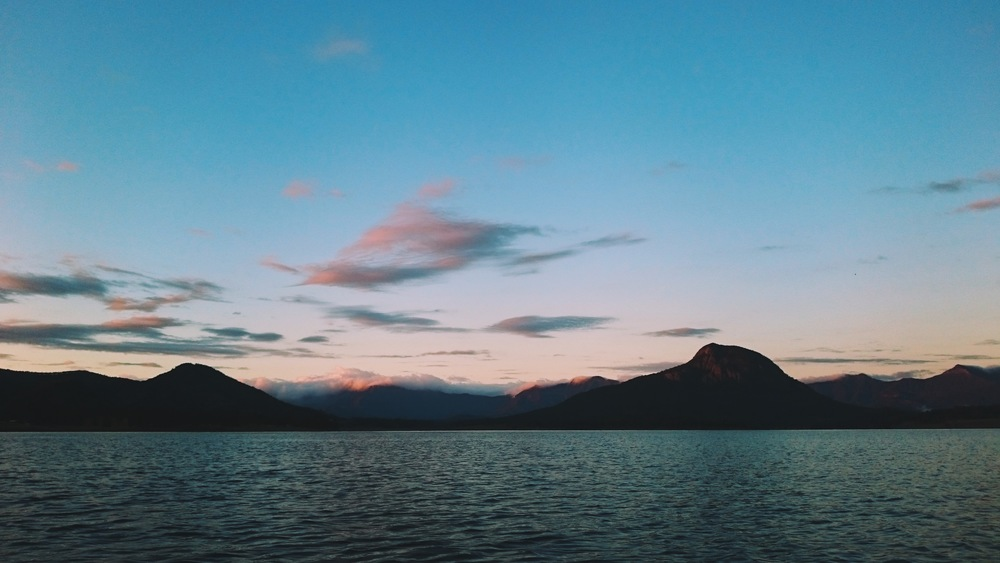 Clouds rolling over the mountains at Sunrise on Lake Moogerah