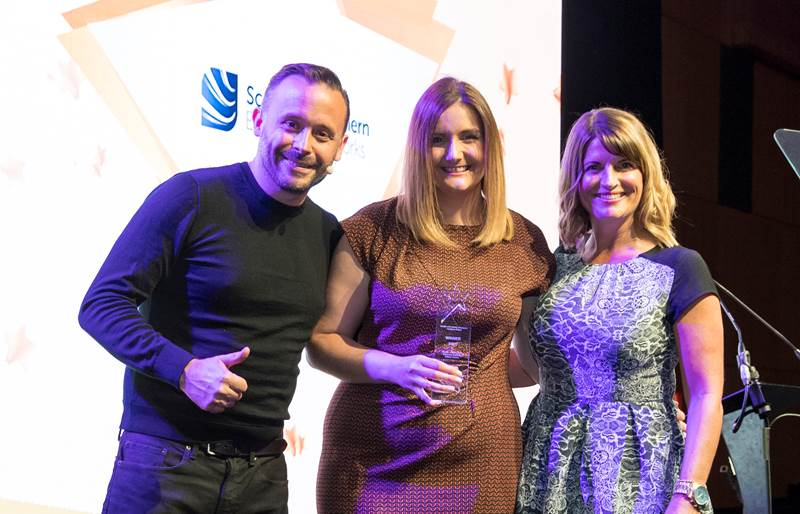 Geoff Norcott, Host of the Utility Week Stars Awards presenting the award to Heather Black from SSEN's Safety, Health and Environment team and Rachel Parry from SSEN's Central Performance team