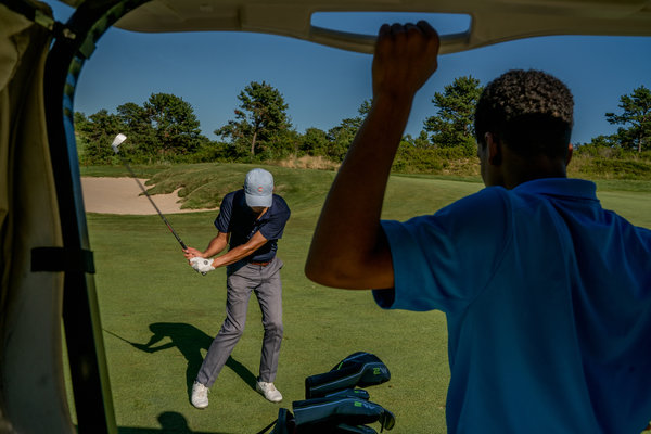 An instructor, Brian Hwang, drives at the Bridge club. Antonio Cortorreal, 15, is one of his students.  Image:  JOHNNY MILANO FOR THE NEW YORK TIMES