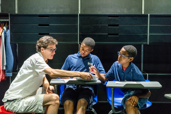 Students must attend classes after school four days a week at the learning center. From left, Charlie Cohen, an instructor, works with Jacob Scarborough and Braylan Stewarts.  Image:  JOHNNY MILANO FOR THE NEW YORK TIMES