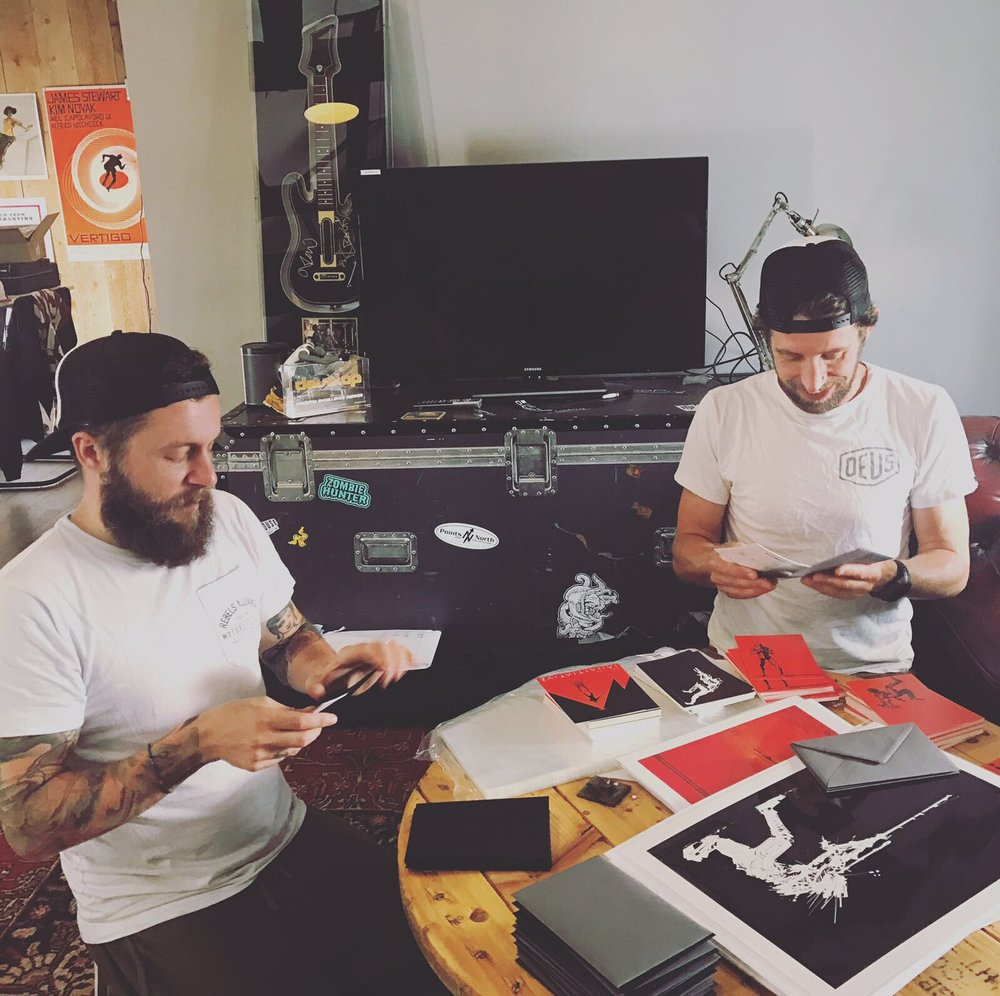Jamie & Dave stuffing envelopes whilst I was formatting custom USB drives out of shot. Gareth signed the big custom prints to the winners on the day.