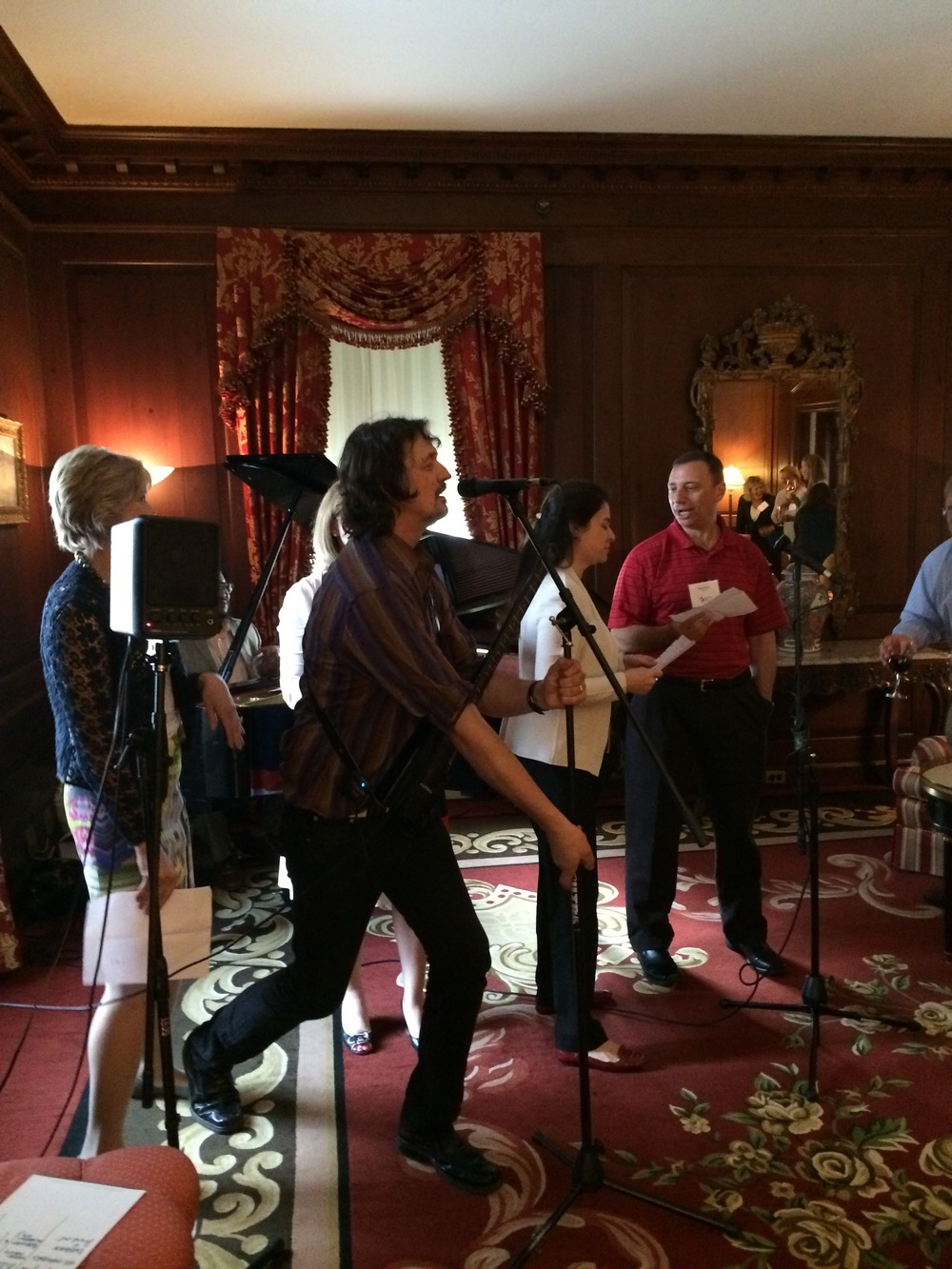 Paul Kwiecinski and Board members from KeyBank, BlackRock, Hopkins Manufacturing and Pfizer sing to the BPI Song with a band at the famed Winston Churchill Suite of the Waldorf Astoria Towers.