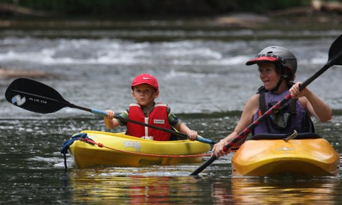 TPA member, Pamela, on the water with an eager young kayaker.