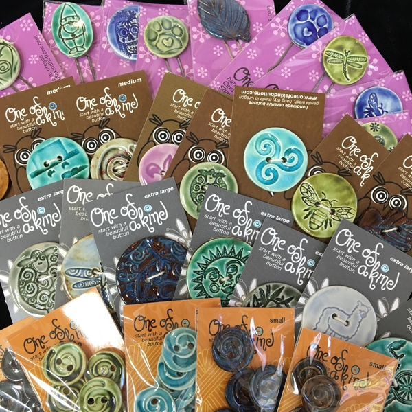 One of a Kind Ceramic Buttons are Packaged on color coded cards.