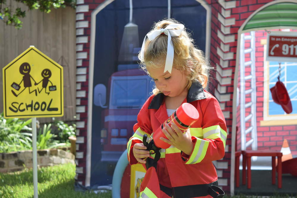 Fire House exterior with girl1.JPG