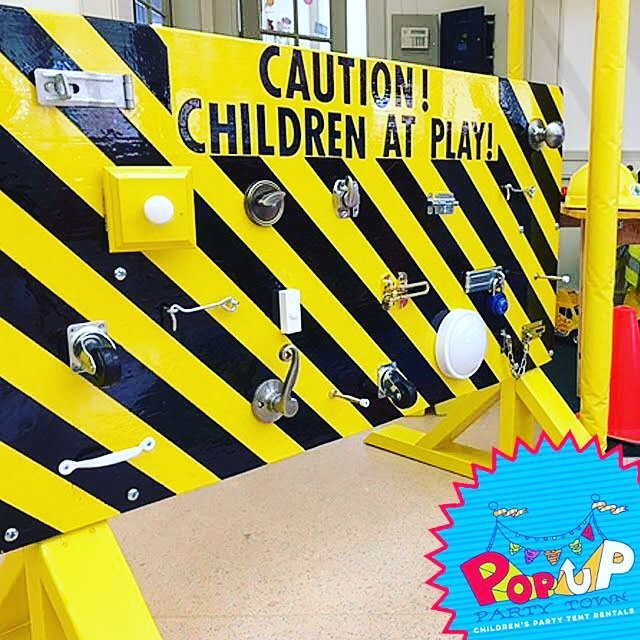Check out our custom made #busyboard. Tons of fun for your little ones. This board is included with the construction site tent along with a sand table, giant buildng blocks and all the tools your kids can handle! #kidspartyideas #kidsfun #nolakids #popupparty