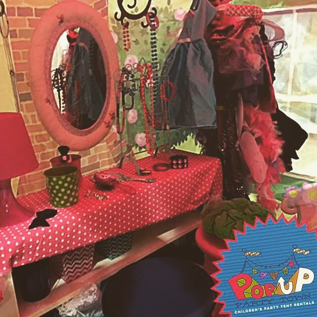 Remember playing dress up with your friends in your mom's closet? Let your kids have a ball doing the same with our House Tent! Ready to play stocked with #dresses, #makeup, #jewelery, and more! #popuppartytown #dressup #playinghouse #kidspartyideas.