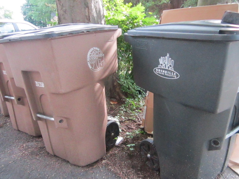 Curbside bins you'll see around town. Brown is for trash and Grayish-Green is for recycling.