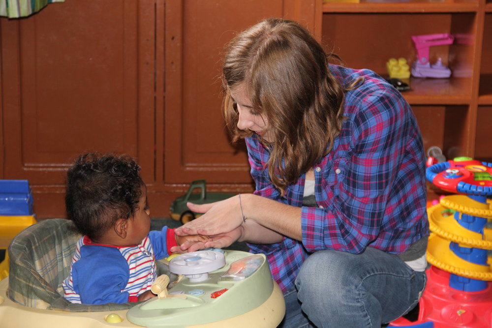 Volunteer with child in Ecuador.