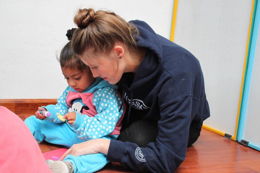 Volunteer with orphan