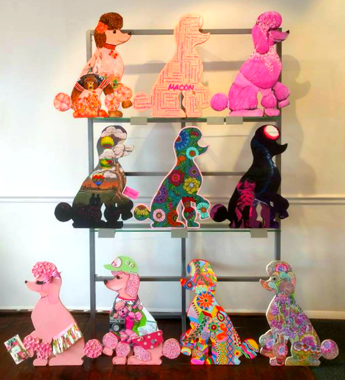 "Painted poodles in the ""Pink Poodle Parade"" exhibit at The 567 Center."