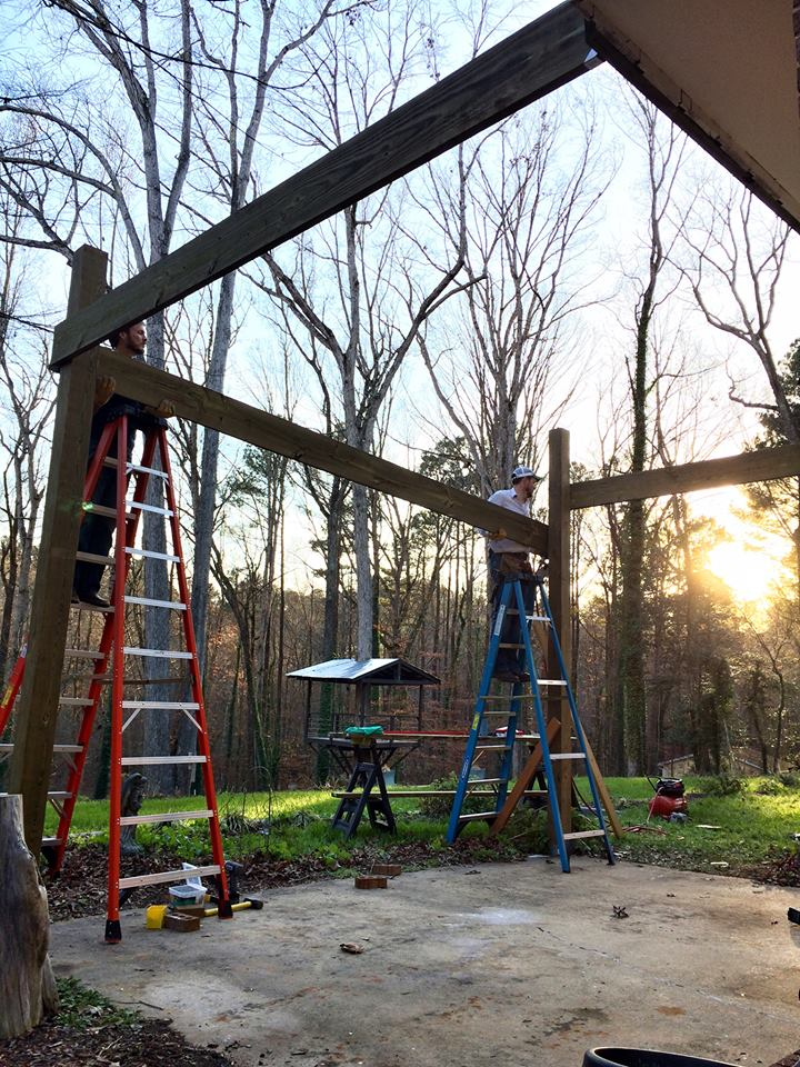 The work goes on forever, and the party never ends.  This pergola over the patio is now (amazingly) completed!