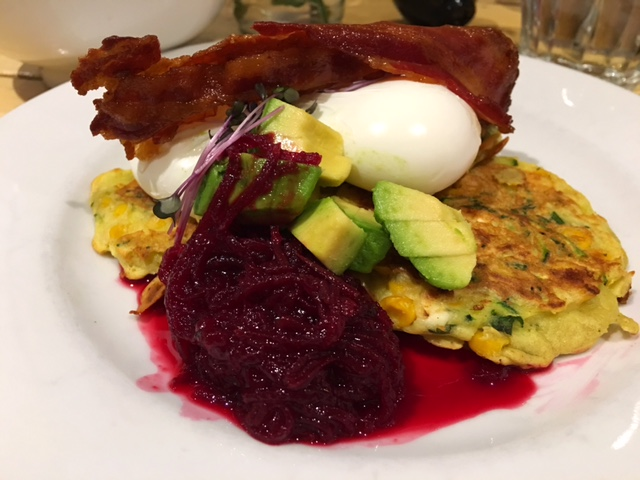 """Sweet As Corn Fritters"" Three fritters packed with organic sweet corn, organic feta, courgette and fresh mint served with two poached organic free range eggs, avocado and homemade beetroot relish."