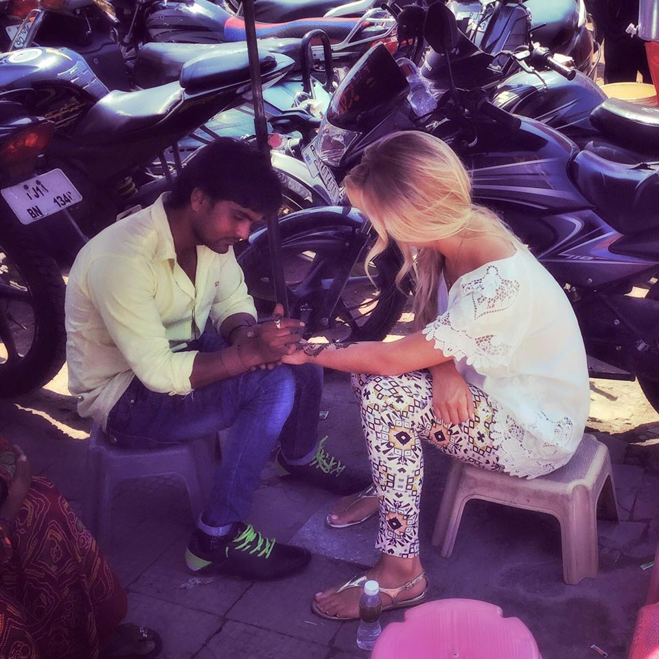 Wearing an Indian-style tunic and legging-type pants at the market while getting my henna