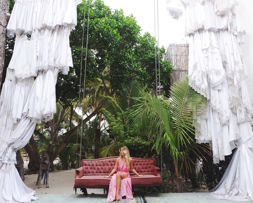 The entrance to Casa Malca is incredible with floating chairs and giant curtains!