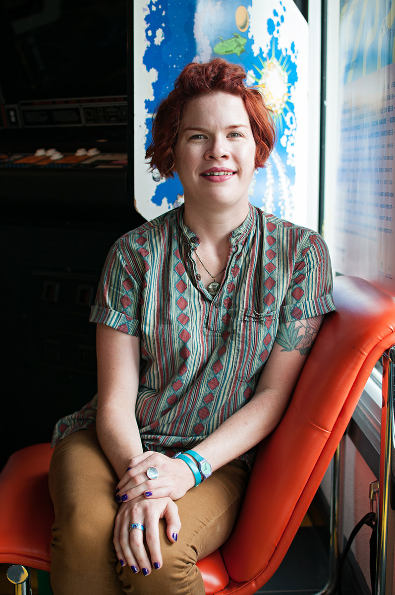 "Sarah Beth is a hairstylist at Bird's Barbershop, and takes public transportation because it improves her quality of life. Her photo was taken at the shop where she works.    ""I feel like when you're on the bus, you can smell the roses a little bit instead of feeling like you're rushing through things. You can actually enjoy just taking a ride and see the city in a different way."""