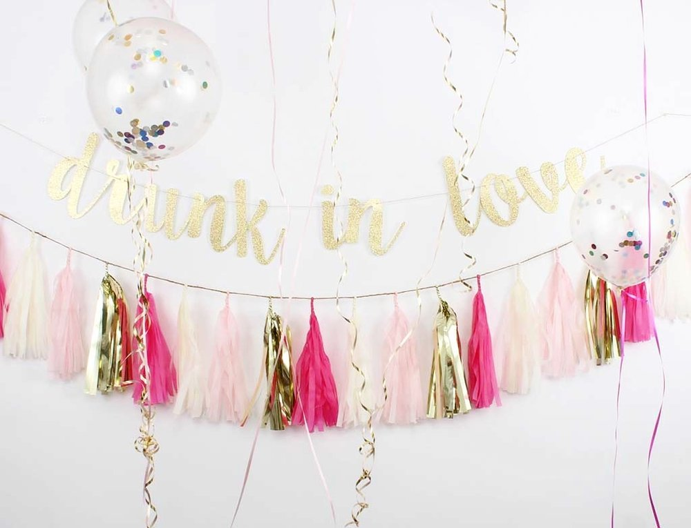 Drunk in Love Banner - $18 | Pink Party Tissue Paper Tassel Garland - $26 | Confetti Balloons - $10