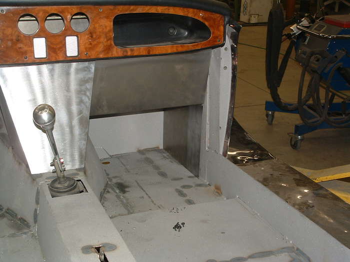 These panels will be covered with leather and the middle water fall will have woodgrain and a 7 inch navigation screen