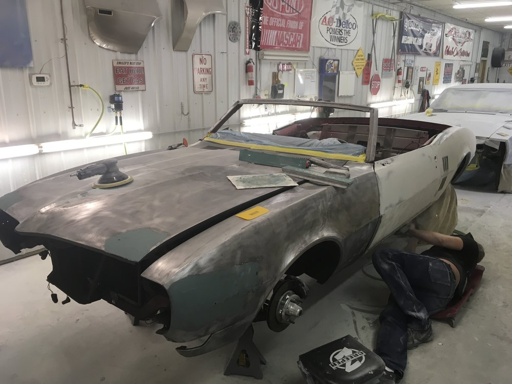 Continuing muddling and sanding Joni's 1968 Firebird