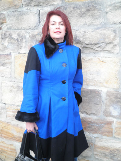 A bright blue and black coat, which includes gorgeous vintage buttons!