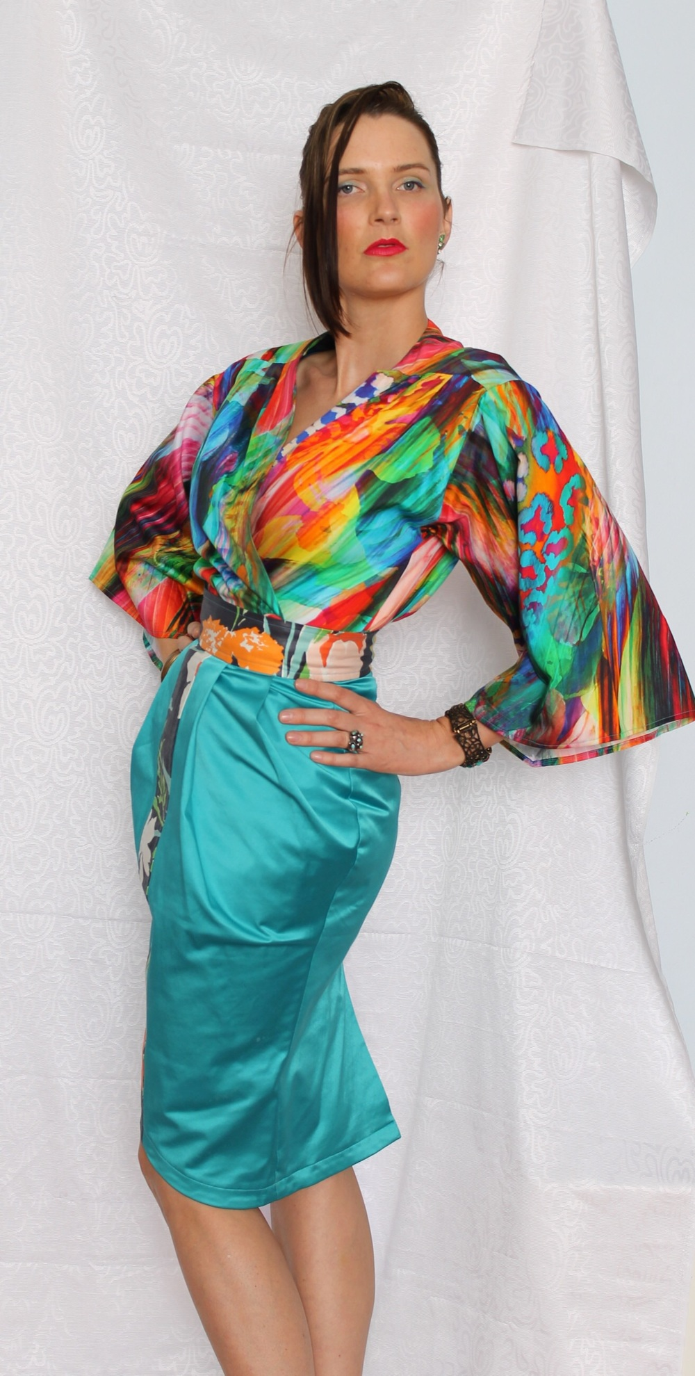The Kaleidoscope Kimono worn with the jade pleated skirt.