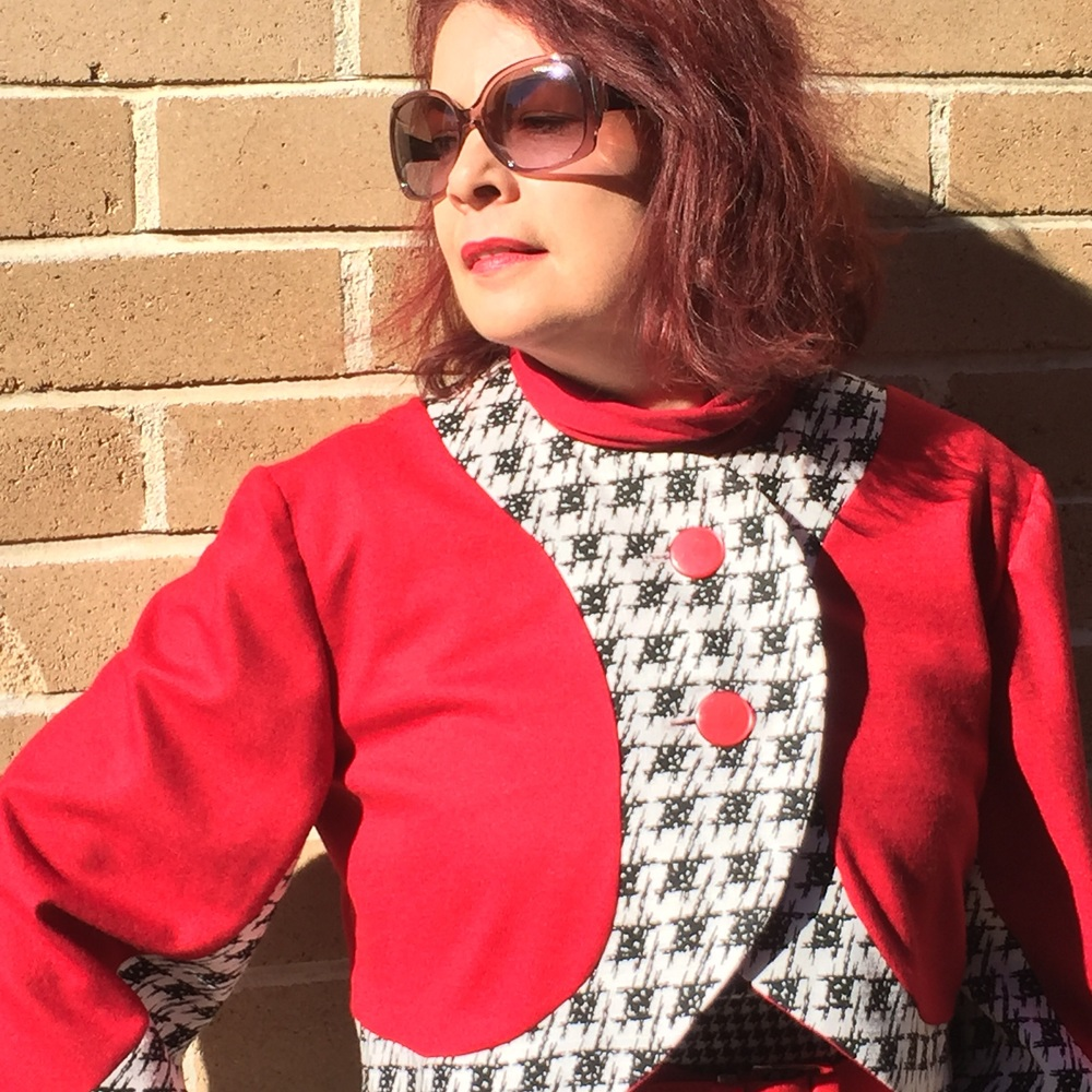 Lorelle wears the Red, Black and White Bolero. This version is still available in a size 8 in the Penelope Red online shop here:  http://www.penelopered.com.au/shop/red-black-and-white-bolero-jacket
