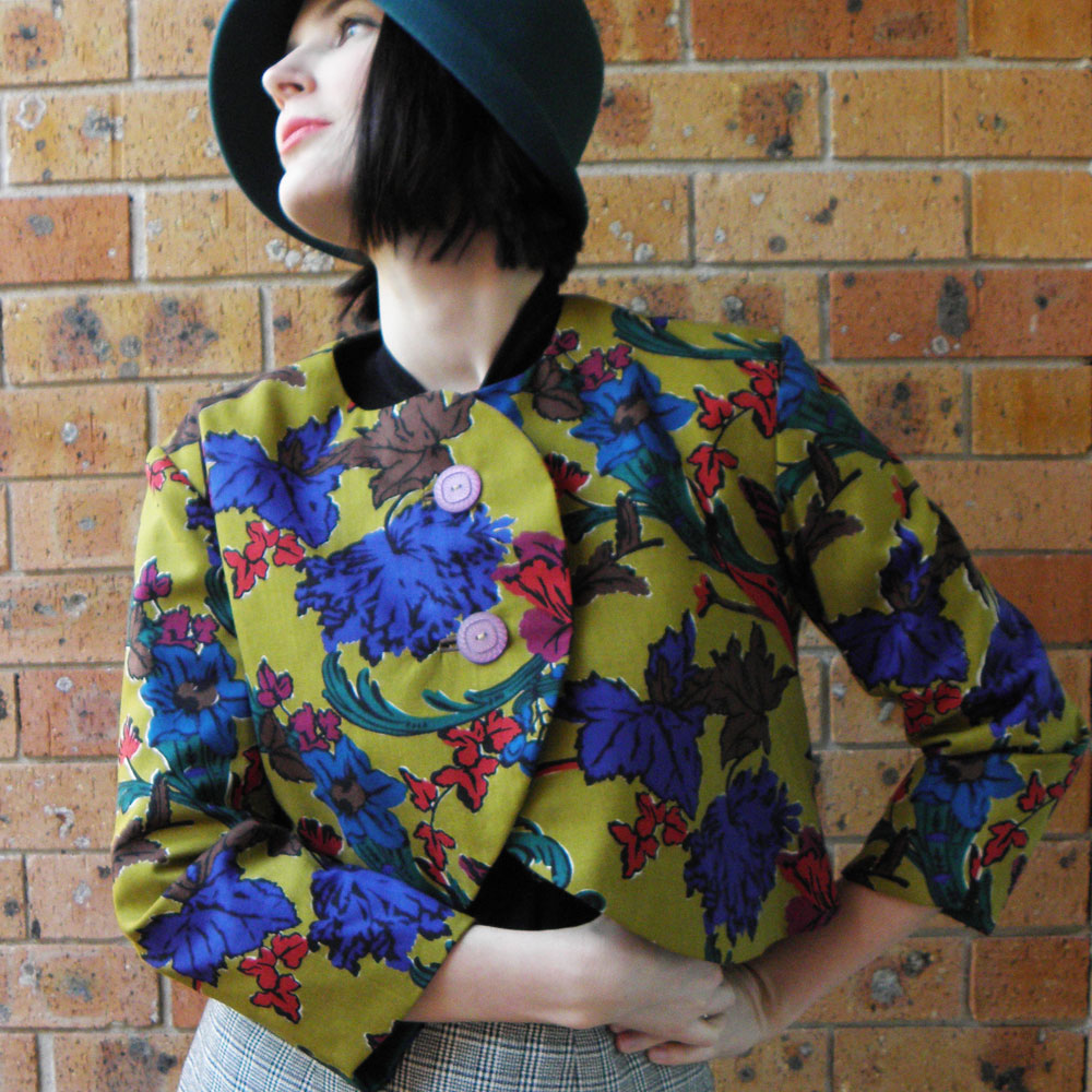 The Liberty Flowers Bolero was handmade from a Liberty of London wool print. I only ever made three copies of this design. It features beautiful vintage buttons, cute little welt button holes and silk lining.