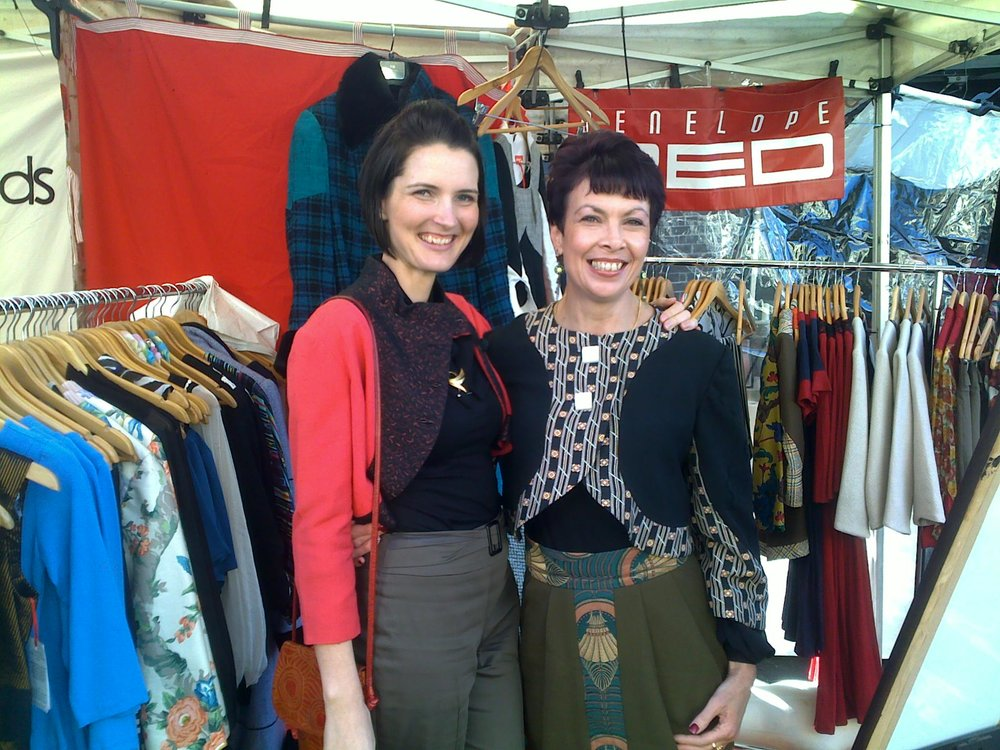 I wear the Cherry Red Bolero and Leanne wears the Black, White and Orange Pyramid Bolero. I think this Pyramid Bolero is one of my most favorite bolero jackets I have made. It features a vintage wool print, and gorgeous vintage buttons.