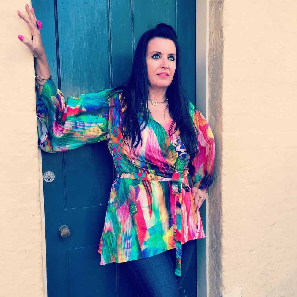 Kat wears the Kaleidoscope Kimono, handmade from a multi coloured and bright cotton print. This kimono is currently available in the Penelope Red online shop here; http://www.penelopered.com.au/shop/the-bright-multi-coloured-kaleidoscope-kimono