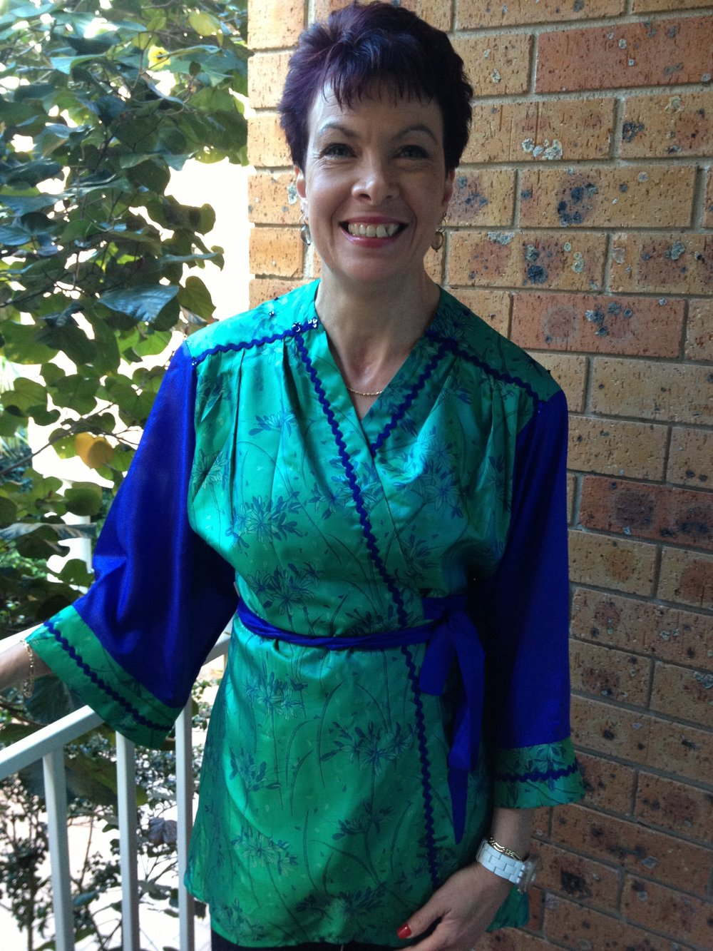 Leanne wears another one of a kind custom order kimono. Leanne wanted an evening version of the kimono, so we chose this vintage bright green silk.