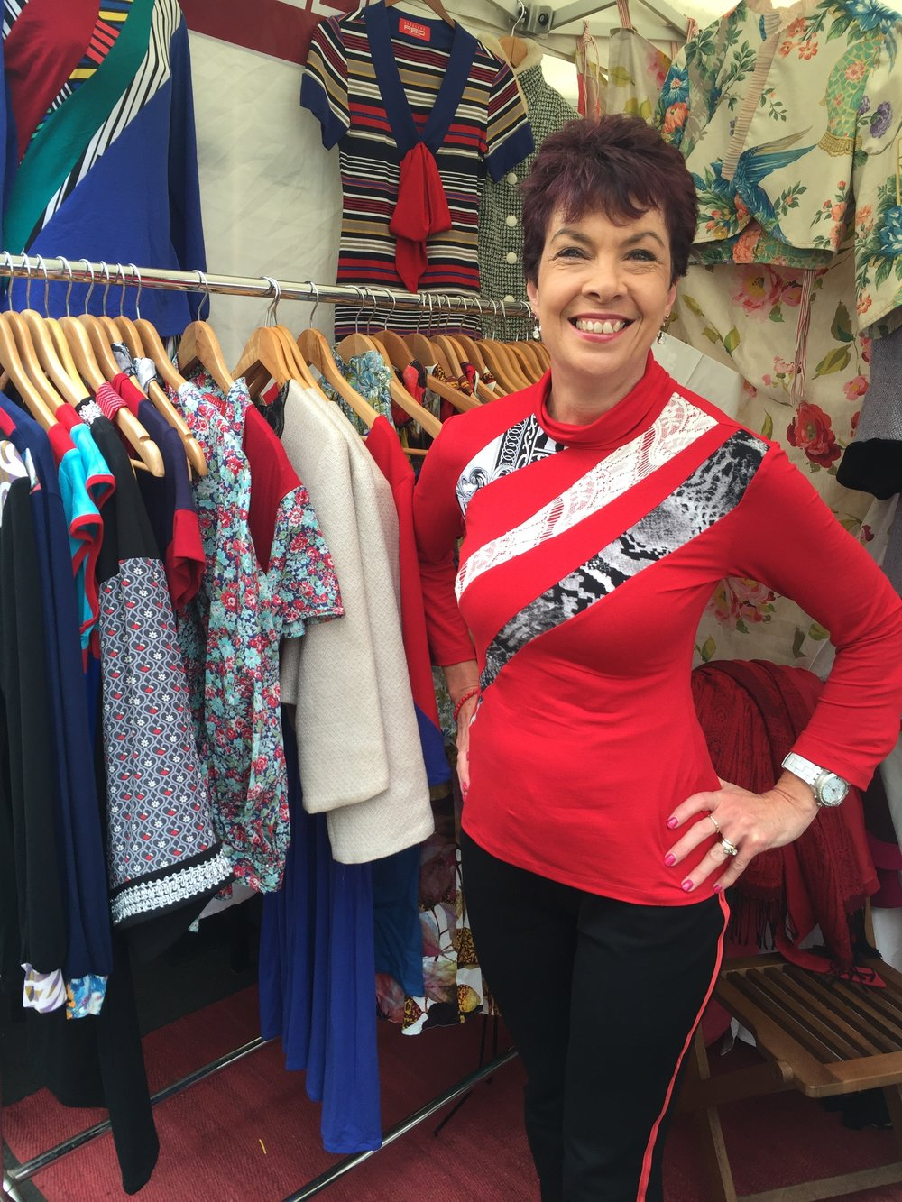 Leanne wears a custom made bright red version of the Jigsaw Skivvy.