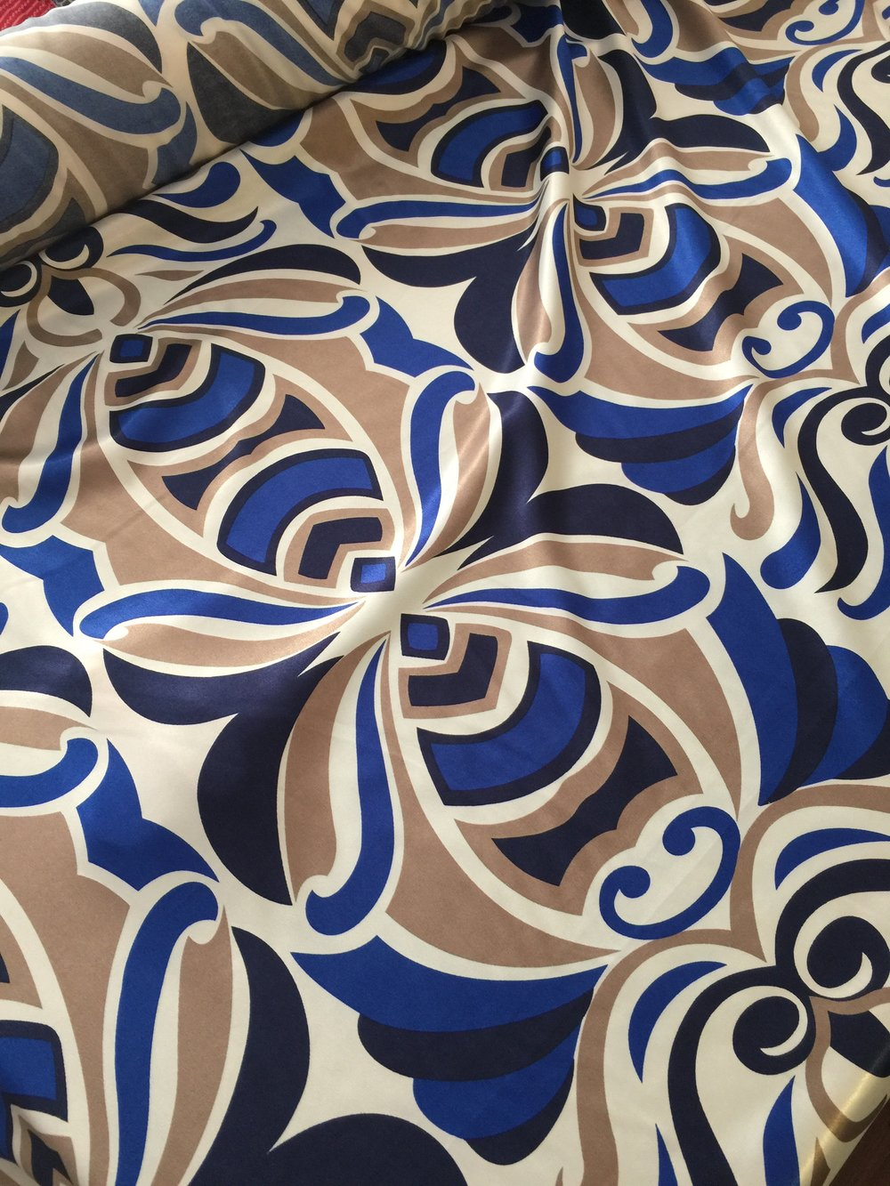 The blue and white satin fabric has a very retro inspired print.