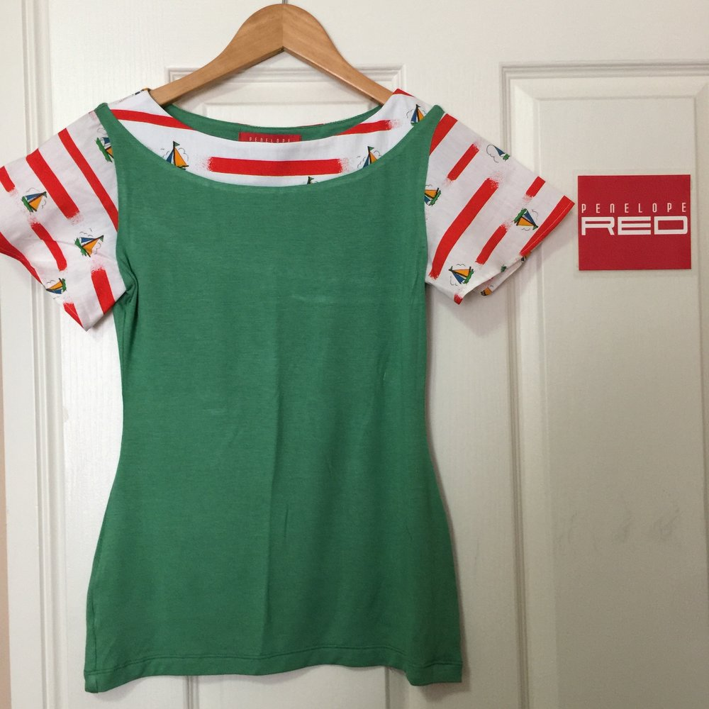 This women's jersey knit top features a bright Apple green stretchy body and contrasting boat neck and short sleeves made from a really cute vintage cotton print with little boats on it.