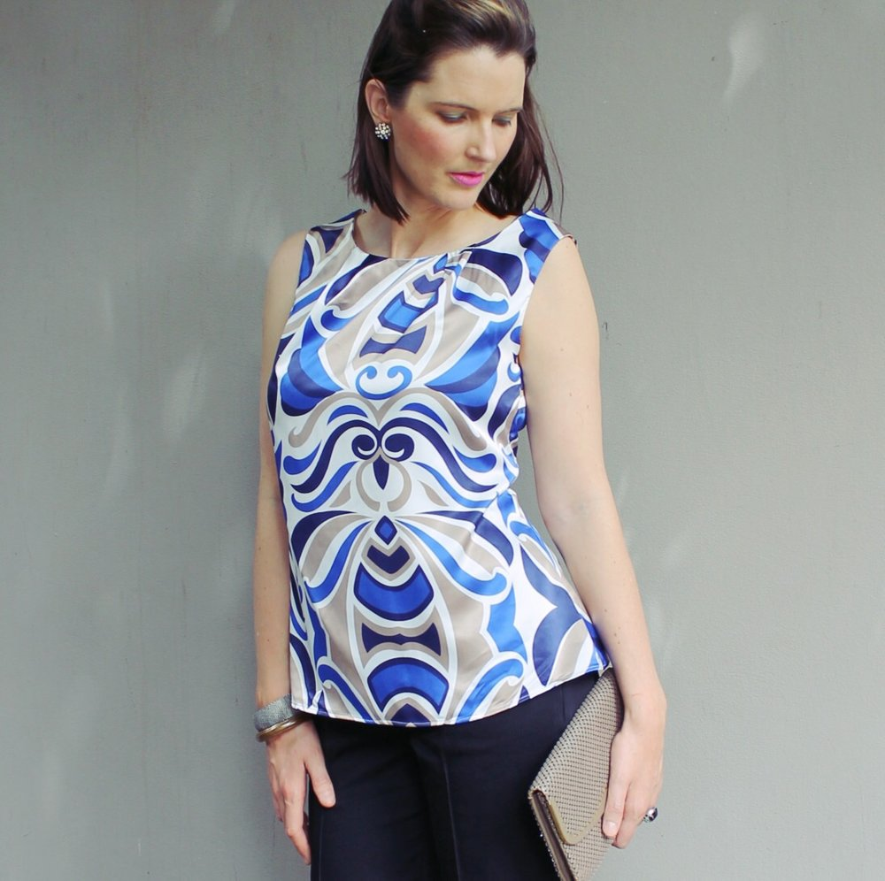 The white and blue satin blouse is a nice loose style that you can wear as a casual top or dress it up.