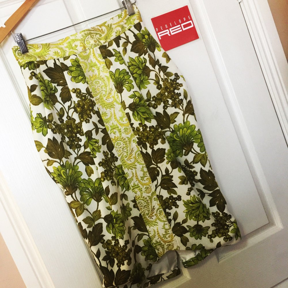 A pleated skirt made from two very stunning vintage fabrics in lime green and various green and gold colours.  only three copies of this skirt will be created.