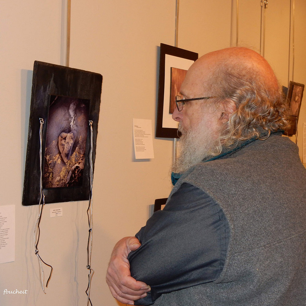 artist Dave Becker enjoying work by Karen Elias
