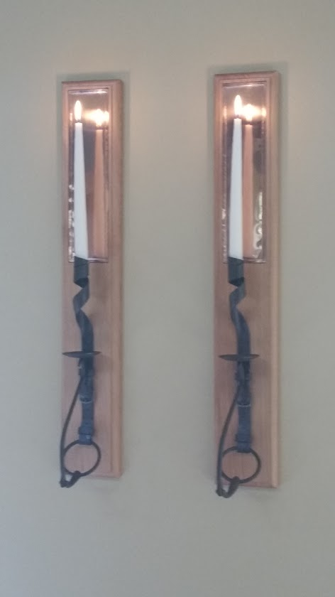 Candle wall sconces. Forged steel horse snaffle bit, copper reflectors, on birds-eye maple.