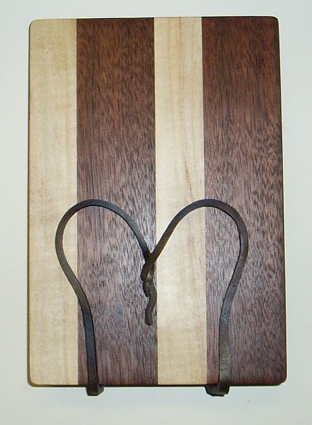 "Cutting Board  Walnut and Maple with oil finish.  6 1/2"" x9 1/2""  Susan Hankin 2009"