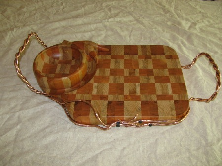 End grain cherry/maple serving tray with attached carved bowl, twisted copper handles.