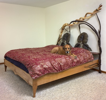 King-size bed. Forged steel, walnut, and sycamore. The dog is not included.