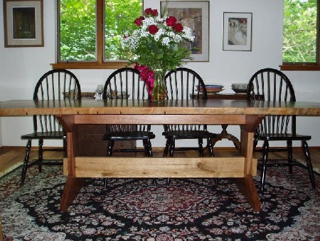 A large dining room table that seats ten. Made from Sapele and white oak.