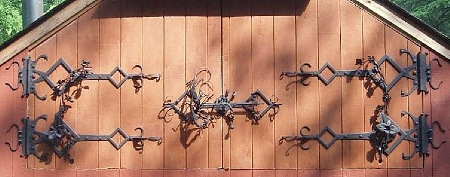 This is an example of hinges for a set of large doors.  The doors measure 6 feet wide (each) by 6 feet high in the center.  The doors have 12 roses and four orchids (representing three different species). Below are additional images of the details of the hinges.