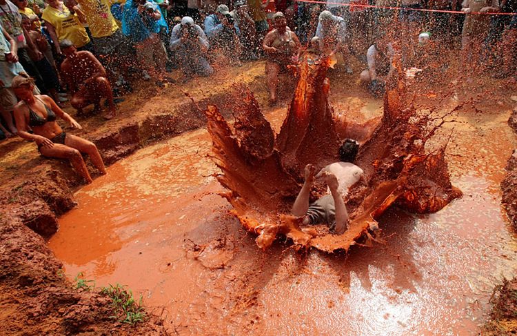 Kyle Keyser doing the Mud Pit Belly Flop at the Redneck Olympics in East Dublin, Georgia. Photo courtesy of National Geographic.